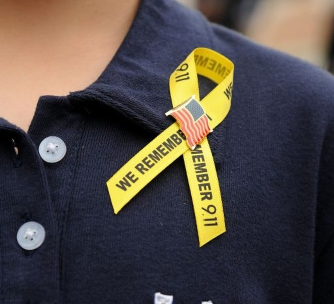 A boy wears a commemorative ribbon during ceremonies marking the tenth anniversary of the September 11, 2001 terrorist attacks on the United States, September 11, 2011 at the Frank Hotchkin Memorial Training Center  in Los Angeles, California. .  AFP PHOTO / ROBYN BECK