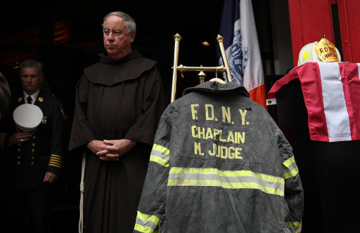 NEW YORK, NY - SEPTEMBER 11: A friar stands near a bunker coat and helmet belonging to FDNY chaplain Mychal Judge during a memorial service and dedication ceremony to induct the two items into the permanent display at the New York City Fire Museum on September 11, 2011 in New York City. New York City firefighters are commemorating the 10th anniversary of the 9/11 terrorist attacks and honoring the 343 firefighters who died in the line of duty.   Justin Sullivan/Getty Images/AFP== FOR NEWSPAPERS, INTERNET, TELCOS & TELEVISION USE ONLY ==