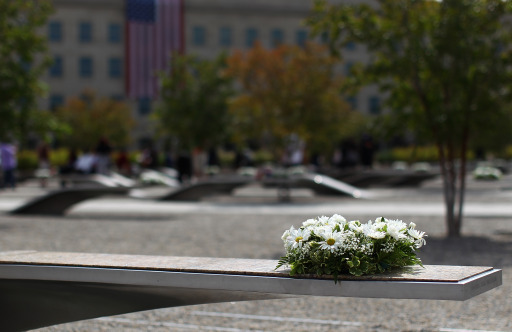 ARLINGTON, VA - SEPTEMBER 11: Following a remembrance ceremony, a wreat lies upon a memorial bench as family members of those who died in the attack on the Pentagon visit the Pentagon Memorial September 11, 2011 in Arlington, Virginia. The nation is commemorating the tenth anniversary of the terrorist attacks which resulted in the deaths of nearly 3,000 people after two hijacked planes crashed into the World Trade Center, one into the Pentagon in Arlington, Virginia and one crash landed in Shanksville, Pennsylvania.   Win McNamee/Getty Images/AFP== FOR NEWSPAPERS, INTERNET, TELCOS & TELEVISION USE ONLY ==