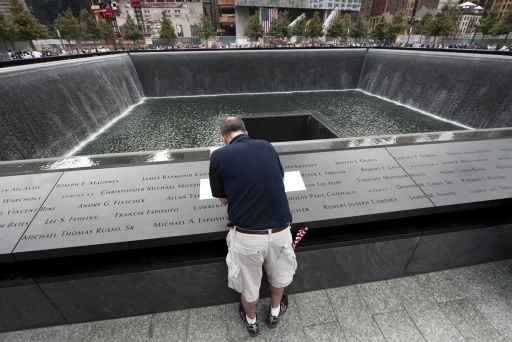 A man traces a name at the 9/11 memorial wall on the South Tower pool of the World Trade Center on September 11, 2011 in New York as the US marks 10 years since the 9/11 attacks. AFP PHOTO/DON EMMERT