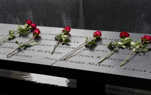 A roses are placed on the 9/11 memorial South Tower pool of the World Trade Center September 11, 2011 in New York as the US marks 10 years since the 9/11 attacks. AFP PHOTO/DON EMMERT