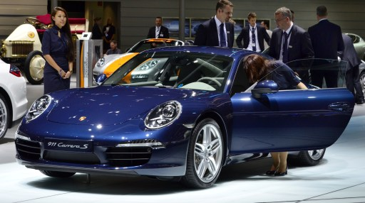 Visitors inspect a new Porsche 911 Carrera S car at the international motor show IAA (Internationale Automobil-Ausstellung) in Frankfurt/M, western Germany, on September 14, 2011. The world's biggest motor show, the IAA, is running from September 15 to 25, 2011.       AFP PHOTO / THOMAS KIENZLE