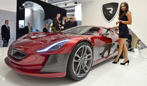 A model poses next to an electric sportscar of Croatian car producer Rimac Automobili at the international motor show IAA (Internationale Automobil-Ausstellung) in Frankfurt/M, western Germany, on September 14, 2011. The world's biggest motor show, the IAA, is running from September 15 to 25, 2011.       AFP PHOTO / THOMAS KIENZLE