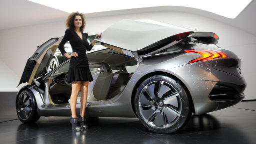 A hostess presents a Peugeot HX1 at the French carmaker booth at the international car show IAA (Internationale Automobil-Ausstellung) in Frankfurt/M., western Germany, on September 13, 2011. The world's biggest motor show, the IAA, is running from September 15 to 25, 2011. AFP PHOTO / ARNE DEDERT== GERMANY OUT