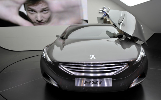 A Peugeot HX1 is presented on the Peugeot booth at the international car show IAA in Frankfurt, western Germany, on September 13, 2011. The world's biggest motor show, the IAA, is running from September 15 to 25, 2011.  AFP PHOTO  THOMAS KIENZLE