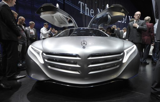 Visitors inspect the Mercedes-Benz F-125  at the international car show IAA in Frankfurt, western Germany, on September 13, 2011. The world's biggest motor show, the IAA, is running from September 15 to 25, 2011.  AFP PHOTO  THOMAS KIENZLE