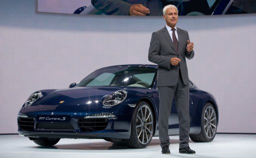 Chairman of sports car manufacturer Porsche, Matthias Mueller, presents the new Porsche 911 during a press day at the international car show IAA (Internationale Automobil-Ausstellung) in Frankfurt/M., western Germany, on September 13, 2011. The world's biggest motor show, the IAA, is running from September 15 to 25, 2011.      AFP PHOTO / UWE ANSPACH GERMANY OUT