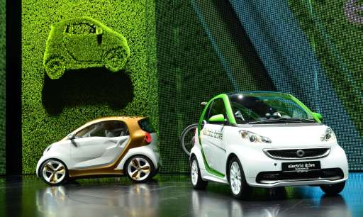 "The new smart electric drive (R) and the smart concept car ""forvision"" by German car maker Daimler AG are on display at the international car show IAA (Internationale Automobil-Ausstellung) in Frankfurt/M., western Germany, on September 13, 2011. The world's biggest motor show, the IAA, is running from September 15 to 25, 2011. (picture taken with zoom effect)   AFP PHOTO  THOMAS KIENZLE"