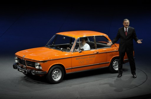 Norbert Reithofer, CEO of German luxury car maker BMW, presents one of the first BMW electric cars, a BMW 1602 from 1972 at the booth of German luxury car maker BMW at the international car show IAA (Internationale Automobil-Ausstellung) in Frankfurt/M., western Germany, on September 13, 2011. The world's biggest motor show, the IAA, is running from September 15 to 25, 2011.  AFP PHOTO  THOMAS KIENZLE