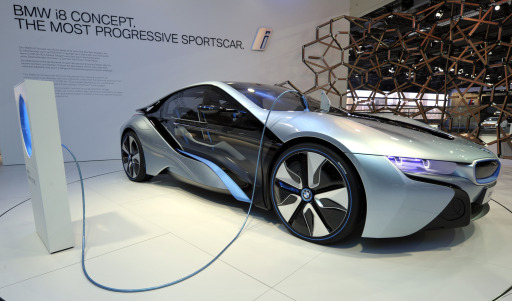 A BMW i8 concept car is connected to a charging station on the booth of German luxury car maker BMW at the international car show IAA (Internationale Automobil-Ausstellung) in Frankfurt/M., western Germany, on September 13, 2011. The world's biggest motor show, the IAA, is running from September 15 to 25, 2011.  AFP PHOTO  THOMAS KIENZLE