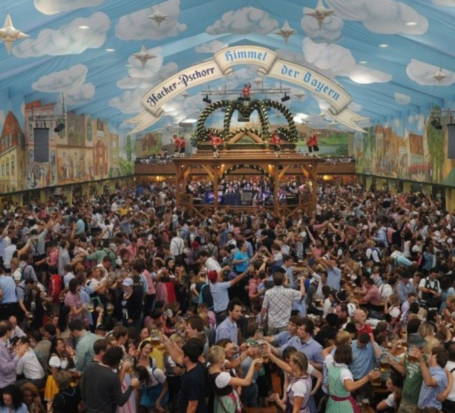 Visitors of the Oktoberfest beer festival celebrate in a beer tent at the Theresienwiese fair grounds in Munich, southern Germany, on September 18, 2011. The world famous beer festival, which is excepted to attract around six million visitors, is running until October 3, 2011.      AFP PHOTO/CHRISTOF STACHE