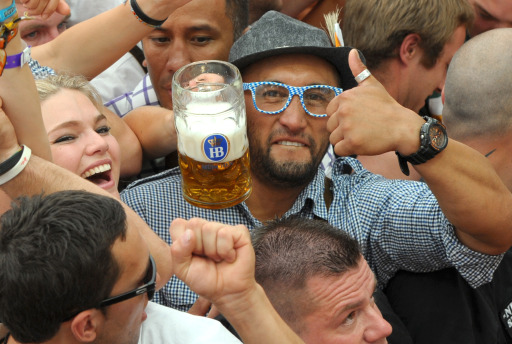 A visitor shows a beer mug in a festival tent of the Oktoberfest beer festival at the Theresienwiese ground in Munich, southern Germany, on September 17, 2011. This year's edition of the world's biggest beer festival Oktoberfest opened today on September 17, and run until October 3, 2011. AFP PHOTO/CHRISTOF STACHE