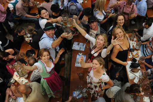 ALTERNATIVE CROP - Visitors of the Oktoberfest beer festival celebrate in a beer tent at the Theresienwiese fair grounds in Munich, southern Germany, on September 18, 2011. The world famous beer festival, which is excepted to attract around six million visitors, is running until October 3, 2011.      AFP PHOTO/CHRISTOF STACHE