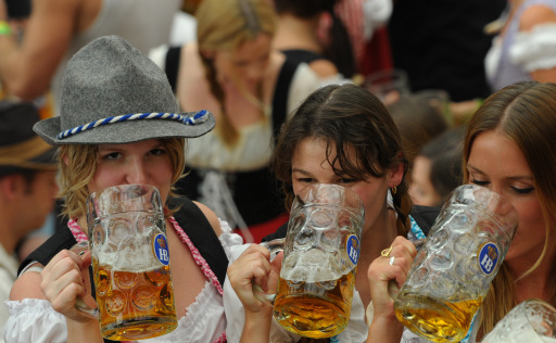Visitors of the Oktoberfest beer festival drink beer in a beer tent at the Theresienwiese fair grounds in Munich, southern Germany, on September 17, 2011. The world famous beer festival, which is excepted to attract around six million visitors, is running until October 3, 2011. AFP PHOTO/CHRISTOF STACHE