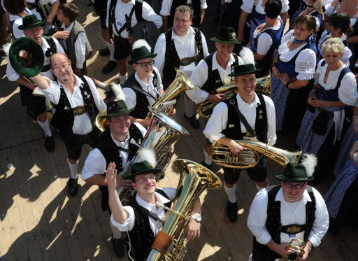 Musicians dressed in traditional Bavarian clothes wave at the start of the Oktoberfest beer festival at the Theresienwiese ground in Munich, southern Germany, on September 17, 2011. The 178th edition of the world's biggest beer festival which excepted to attract around six million visitors starts today and runs until October 3, 2011. AFP PHOTO / CHRISTOF STACHE