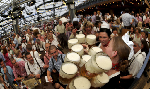 A waitress serves beer mugs in a festival tent at the start of the Oktoberfest beer festival at the Theresienwiese ground in Munich, southern Germany, on September 17, 2011. The 178th edition of the world's biggest beer festival which excepted to attract around six million visitors starts today and runs until October 3, 2011.  AFP PHOTO / FRANK LEONHARDT ++ GERMANY OUT