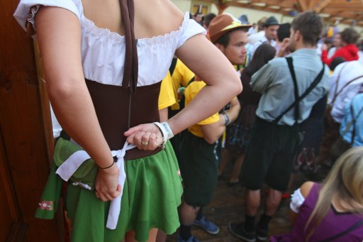 A woman dressed with traditional Bavarian clothes wait gets ready early in the morning as she waits before the start of the Oktoberfest beer festival at the Theresienwiese ground in Munich, southern Germany, on September 17, 2011. The 178th edition of the world's biggest beer festival which excepted to attract around six million visitors starts today and runs until October 3, 2011.  AFP PHOTO / KARL-JOSEF HILDENBRAND ++ GERMANY OUT