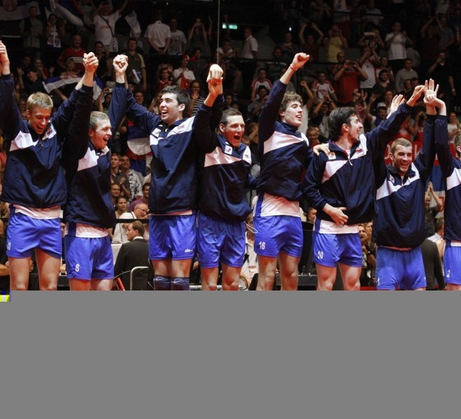 Serbia's players celebrate their victory on the podium at the end of the men's European Volleyball Championships gold medal match against Italy in Vienna on September 18, 2011. Serbia won 3:1.      AFP PHOTO/ DIETER NAGL
