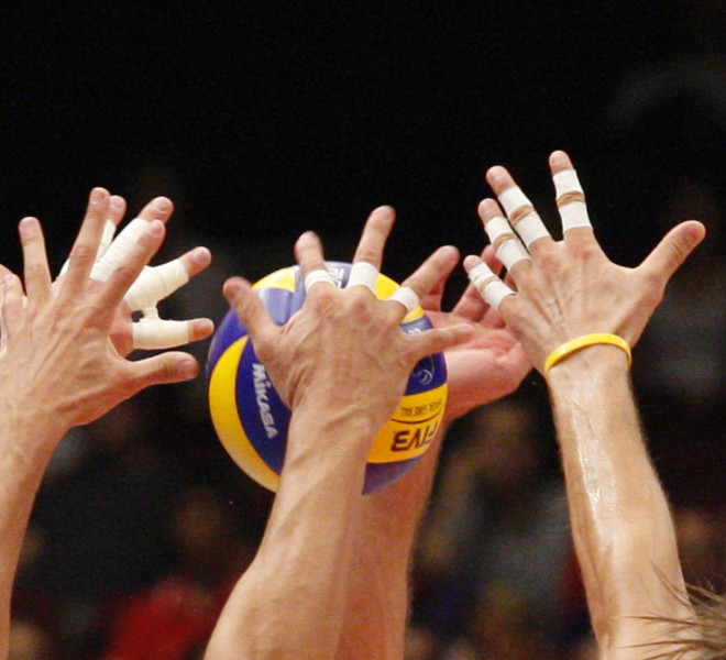A Serbian player smashes the ball during the men's Volleyball European Championship final between Italy and Serbia in Vienna on September 18, 2011.     AFP PHOTO/ DIETER NAGL