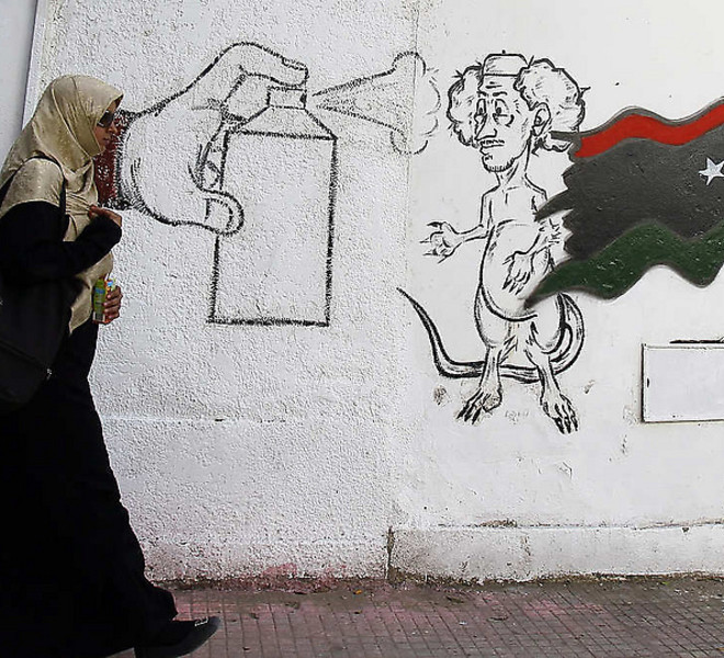 A graffiti depicting Libya's ousted Moammar Gadhafi on a street in Tripoli, Libya, Tuesday, Sept. 20, 2011.  Libyan graffiti artists are taking advantage of newfound freedom to make fun of ousted leader Moammar Gadhafi on the streets of Tripoli, after 42-years of authoritarian rule artists are able to express themselves in public spaces. (AP Photo/Francois Mori)