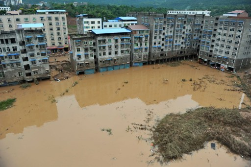 In this picture taken on September 19, 2011, flood waters swamp a neighbourhood in Guangan, southwest China's Sichuan province, as unprecedented rains over the past week have swamped parts of northern, central and southwest China. Heavy rains and floods across China have left 57 people dead, dozens of others missing and hundreds injured, while more than a million residents have been evacuated from their homes, the government said.      CHINA OUT      AFP PHOTO