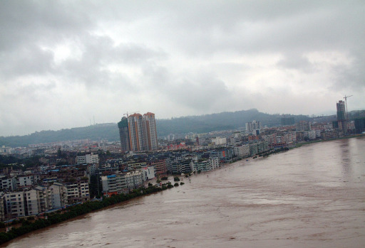 The swelling river rises in Guangan city, southwest China's Sichuan province on September 20, 2011, as unprecedented rains over the past week have swamped parts of northern, central and southwest China. Heavy rains and floods across China have left 57 people dead, dozens of others missing and hundreds injured, while more than a million residents have been evacuated from their homes, the government said.      CHINA OUT      AFP PHOTO