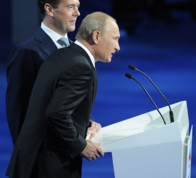"Russia's President Dmitry Medvedev (L) and Prime Minister Vladimir Putin make a joint appearance at a congress of the United Russia ruling party in Moscow, on September 24, 2011. Putin accepted today a proposal by Medvedev to stand for Russian president in 2012 polls, saying it was a ""great honour"".  AFP PHOTO / NATALIA KOLESNIKOVA"