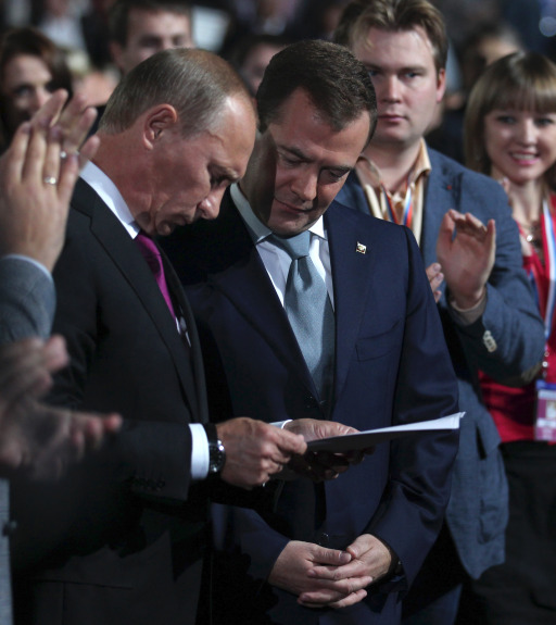"Russia's President Dmitry Medvedev (R) and Prime Minister Vladimir Putin (L) take part in a congress of the United Russia ruling party in Moscow, on September 24, 2011.  Putin accepted today a proposal by Medvedev to stand for Russian president in 2012 polls, saying it was a ""great honour"".AFP PHOTO/ RIA-NOVOSTI/ KREMLIN POOL/  YEKATERINA SHTUKINA"
