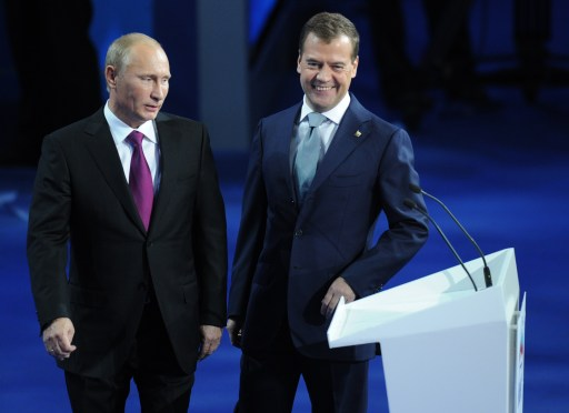 "Russia's President Dmitry Medvedev (R) and Prime Minister Vladimir Putin make a joint appearance at a congress of the United Russia ruling party in Moscow, on September 24, 2011. Putin accepted today a proposal by Medvedev to stand for Russian president in 2012 polls, saying it was a ""great honour"".  AFP PHOTO / NATALIA KOLESNIKOVA"