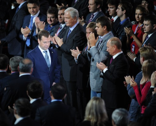 "Russia's Prime Minister Vladimir Putin (R)  applauds to President Dmitry Medvedev (L)  as he walks during a congress of the United Russia ruling party in Moscow, on September 24, 2011. Putin accepted today a proposal by Medvedev to stand for Russian president in 2012 polls, saying it was a ""great honour"".  AFP PHOTO / NATALIA KOLESNIKOVA"