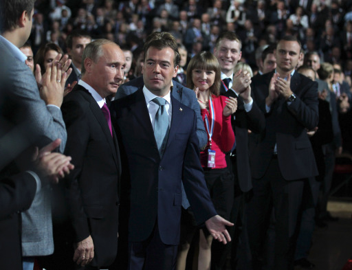 "Russia's President Dmitry Medvedev (R) and Prime Minister Vladimir Putin (L) speak during a congress of Russia's ruling party in Moscow, on September 24, 2011.  Putin accepted today a proposal by Medvedev to stand for Russian president in 2012 polls, saying it was a ""great honour"".AFP PHOTO/ RIA-NOVOSTI/ KREMLIN POOL/  YEKATERINA SHTUKINA"