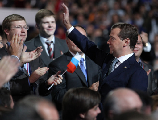"President Dmitry Medvedev (R) greets the audience during a congress of the United Russia ruling party in Moscow, on September 24, 2011.  Prime Minister Vladimir Putin  accepted today a proposal by Medvedev to stand for Russian president in 2012 polls, saying it was a ""great honour"".AFP PHOTO/ RIA-NOVOSTI/ KREMLIN POOL/  YEKATERINA SHTUKINA"