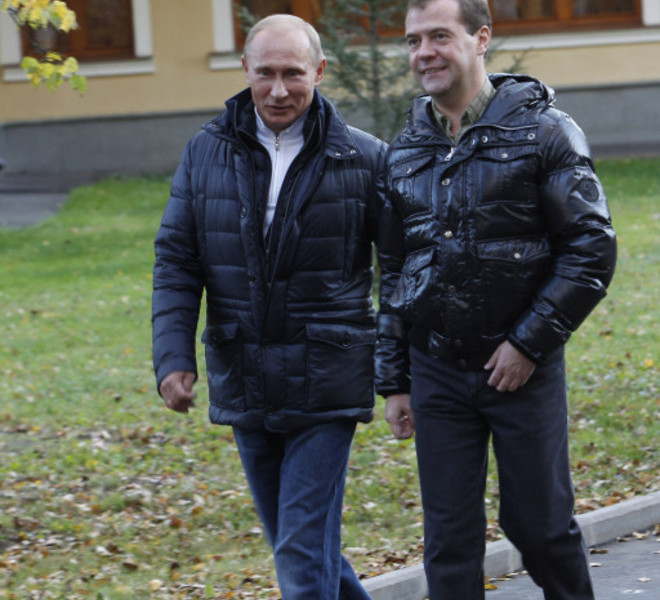 "Russia's President Dmitry Medvedev (R) speaks with Prime Minister Vladimir Putin as they walk at the Zavidovo residence in the Tver region, on September 24, 2011. Putin accepted today a proposal by Medvedev to stand for Russian president in 2012 polls, saying it was a ""great honour"". AFP PHOTO/ RIA-NOVOSTI/ KREMLIN POOL/ VLADIMIR RODIONOV"