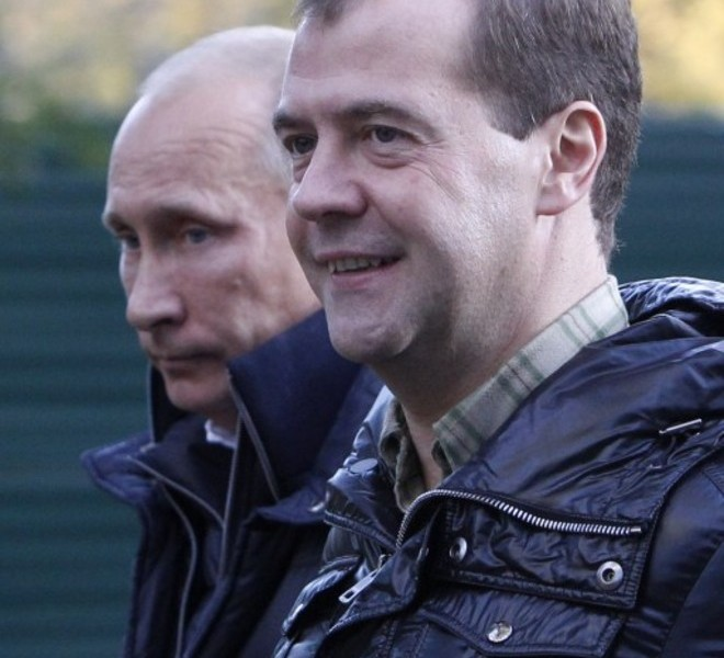 "Russia's President Dmitry Medvedev (R) and Prime Minister Vladimir Putin walk at the Zavidovo residence in the Tver region, on September 24, 2011. Putin accepted today a proposal by Medvedev to stand for Russian president in 2012 polls, saying it was a ""great honour"". AFP PHOTO/  POOL/  SERGEI KARPUKHIN"
