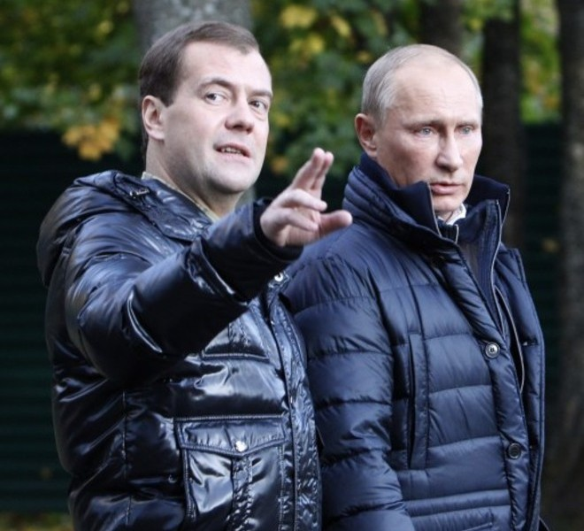 "Russia's President Dmitry Medvedev (L) speaks with Prime Minister Vladimir Putin as they walk at the Zavidovo residence in the Tver region, on September 24, 2011. Putin accepted today a proposal by Medvedev to stand for Russian president in 2012 polls, saying it was a ""great honour"". AFP PHOTO/  POOL/  SERGEI KARPUKHIN"