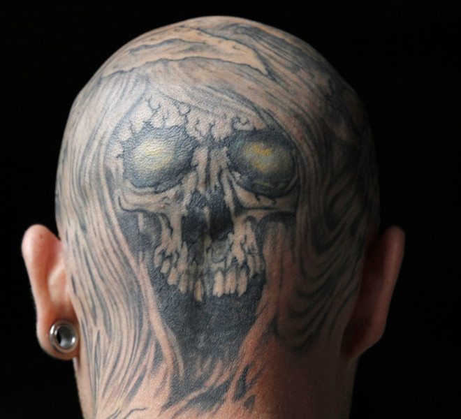 A man displays a tattoo on his head at the London International Tattoo Convention in London September 25, 2011.    REUTERS/Luke MacGregor  (BRITAIN - Tags: SOCIETY)