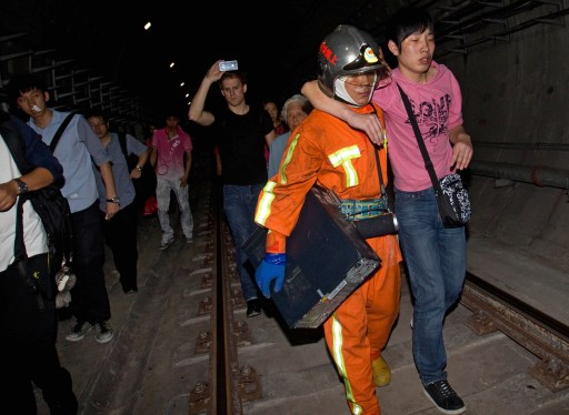 Rescuers evacuate passengers after a subway train collision in Shanghai on September 27, 2011. A crash between two metro trains in the Chinese city of Shanghai injured more than 40 people, most of them lightly, as more than 500 passengers have been evacuated from the trains after the collision, which was apparently caused by a signal failure.    CHINA OUT      AFP PHOTO