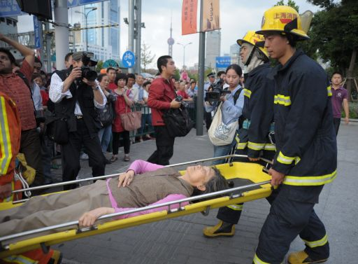 Chinese rescuers evacuate an injured passenger after a subway train collision in Shanghai on September 27, 2011. A crash between two metro trains in the Chinese city of Shanghai injured more than 40 people, most of them lightly, as more than 500 passengers have been evacuated from the trains after the collision, which was apparently caused by a signal failure.                        CHINA OUT      AFP PHOTO