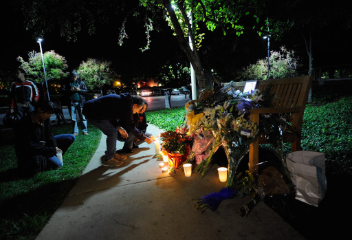 CUPERTINO, CA - OCTOBER 05: People light candles at a makeshift memorial for Steve Jobs at the Apple headquarters on October 5, 2011 in Cupertino, California. Jobs, 56, passed away after a long battle with pancreatic cancer. Jobs co-founded Apple in 1976 and is credited, along with Steve Wozniak, with marketing the world's first personal computer in addition to the popular iPod, iPhone and iPad.   Kevork Djansezian/Getty Images/AFP== FOR NEWSPAPERS, INTERNET, TELCOS & TELEVISION USE ONLY ==