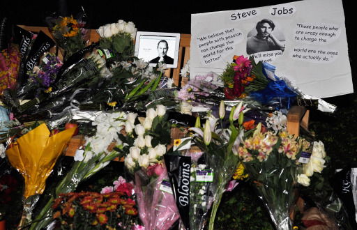 CUPERTINO, CA - OCTOBER 05: Flowers and an iPad showing a picture of Steve Jobs are placed at a makeshift memorial for Steve Jobs at the Apple headquarters on October 5, 2011 in Cupertino, California. Jobs, 56, passed away after a long battle with pancreatic cancer. Jobs co-founded Apple in 1976 and is credited, along with Steve Wozniak, with marketing the world's first personal computer in addition to the popular iPod, iPhone and iPad.   Kevork Djansezian/Getty Images/AFP== FOR NEWSPAPERS, INTERNET, TELCOS & TELEVISION USE ONLY ==