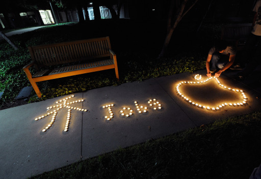 CUPERTINO, CA - OCTOBER 05: Chinese exchange students from nearby De Anza College use candles to create the Apple logo and Steve Jobs' last name in Chinese characters at a makeshift memorial for Steve Jobs at the Apple headquarters on October 5, 2011 in Cupertino, California. Jobs, 56, passed away after a long battle with pancreatic cancer. Jobs co-founded Apple in 1976 and is credited, along with Steve Wozniak, with marketing the world's first personal computer in addition to the popular iPod, iPhone and iPad.   Kevork Djansezian/Getty Images/AFP== FOR NEWSPAPERS, INTERNET, TELCOS & TELEVISION USE ONLY ==
