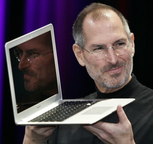 "(FILES): This January 15, 2008 file photo shows Apple CEO and co-founder Steve Jobs showing off the new Macbook Air ultra portable laptop during his keynote speech at the MacWorld Conference & Expo in San Francisco.   Apple on Wednesday, October 5, 2011 announced the death of its visionary co-founder Steve Jobs from cancer at 56.  ""We are deeply saddened to announce that Steve Jobs passed away today,"" the company's board of directors said in a statement.          AFP PHOTO/ Files / Tony AVELAR"