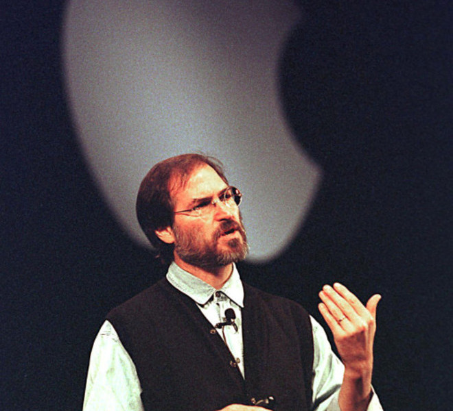 "(FILES): This November 10, 1997 file photo shows Apple co-founder Steve Jobs speaking at a press conference in Cupertino, CA.  Apple on Wednesday, October 5, 2011 announced the death of its visionary co-founder Steve Jobs from cancer at 56.   ""We are deeply saddened to announce that Steve Jobs passed away today,"" the company's board of directors said in a statement.      AFP PHOTO / Files / John G. MABANGLO"