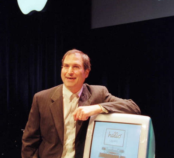 "(FILES): This May 6, 1998 file photo shows Apple co-founder Steve Jobs unveiling a new computer called the iMac in Cupertino, California.  Apple on Wednesday, October 5, 2011 announced the death of its visionary co-founder Steve Jobs from cancer at 56.  ""We are deeply saddened to announce that Steve Jobs passed away today,"" the company's board of directors said in a statement.   AFP PHOTOS / Files / John G. MABANGLO"