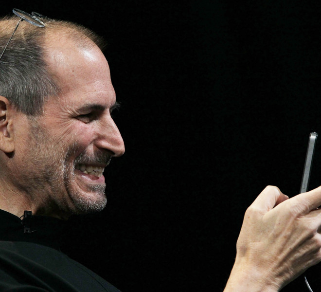 SAN FRANCISCO - JUNE 07:  Apple CEO Steve Jobs demonstrates the new iPhone 4 as he delivers the opening keynote address at the 2010 Apple World Wide Developers conference June 7, 2010 in San Francisco, California. Jobs kicked off their annual WWDC with the announcement of the new iPhone 4  (Photo by Justin Sullivan/Getty Images)