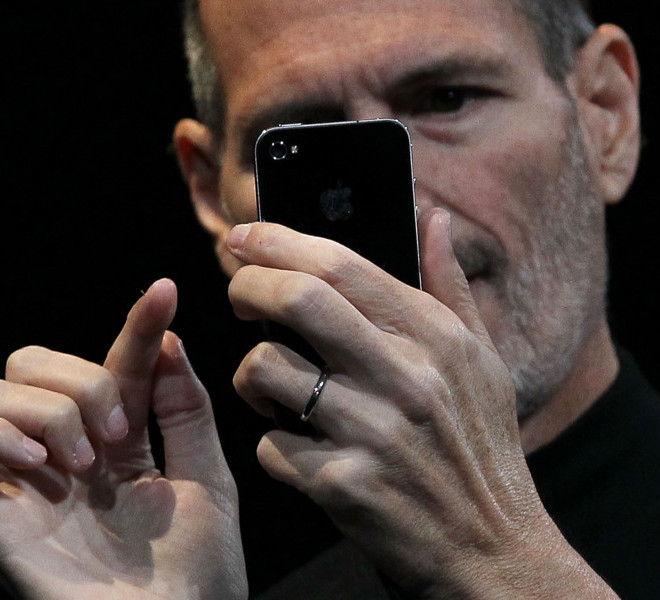 SAN FRANCISCO - JUNE 07: Apple CEO Steve Jobs demonstrates the new iPhone 4 as he delivers the opening keynote address at the 2010 Apple World Wide Developers conference June 7, 2010 in San Francisco, California. Jobs kicked off the annual WWDC with the official unveiling of the latest version of the iPhone. (Photo by Justin Sullivan/Getty Images)