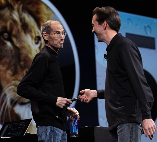 SAN FRANCISCO, CA - JUNE 06:  Apple CEO Steve Jobs (L) jokes with Scott Forstall, Senior VP of iPhone Software as he delivers the keynote address at the 2011 Apple World Wide Developers Conference at the Moscone Center on June 6, 2011 in San Francisco, California. Apple CEO Steve Jobs returned from sick leave to introduce Apple's new iCloud storage system and the next versions of Apple's iOS and Mac OSX.  (Photo by Justin Sullivan/Getty Images)