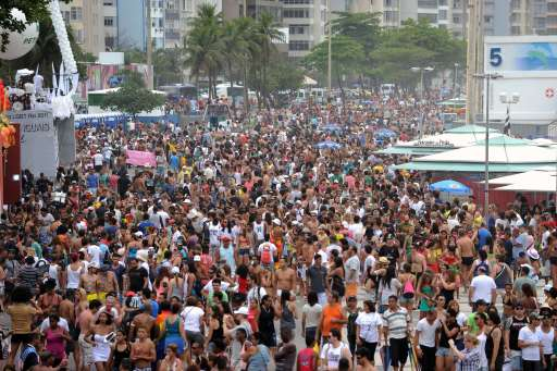 Thousands of people participate in the Gay Pride Parade along Rio de Janeiro's Copacabana Beach on October 9, 2011. Organizers are expecting more than 2 million people for the latest edition of the Gay Parade in Rio.  AFP PHOTO/VANDERLEI ALMEIDA