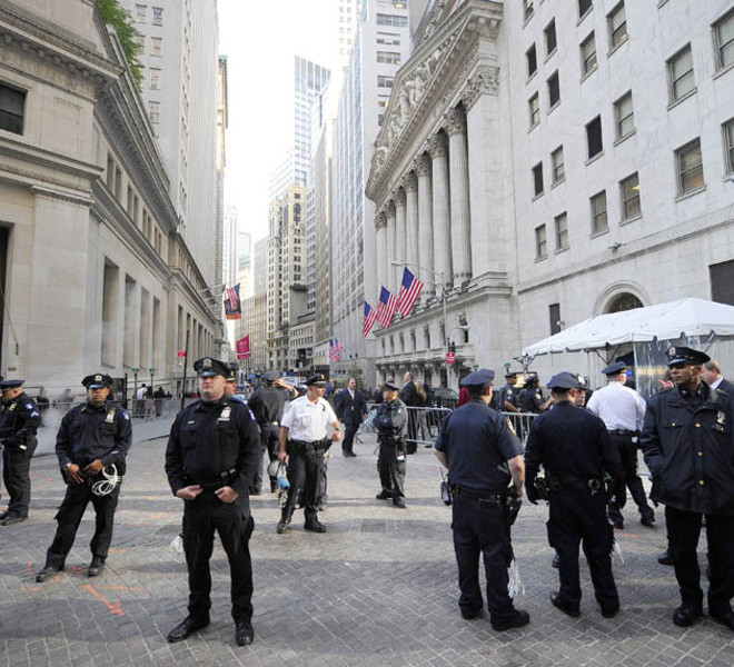 "Policemen stand guard around the New York Stock Exchange as Participants in the Occupy Wall Street demonstrate around Wall Street, in New York, September 19, 2011. Hundreds of demonstrators, who descended on Lower Manhattan on Saturday with the aim of staying at least until the open of the New York Stock Exchange on Monday, had planned to turn the area into an ""American Tahrir Square."" AFP PHOTO/Emmanuel Dunand (Photo credit should read EMMANUEL DUNAND/AFP/Getty Images)"