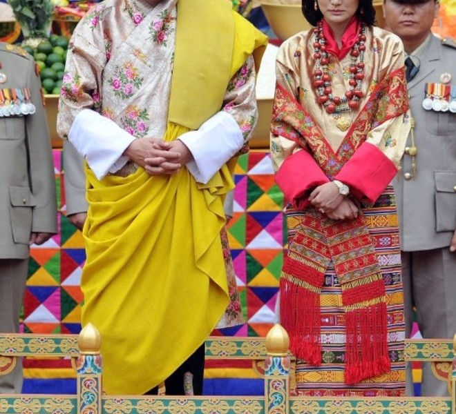 King of Bhutan Jigme Khesar Namgyel Wangchuck (L) and future queen Jetsun Pema (R) stand together during their marriage ceremony in the main courtyard of the 17th-century fortified monastery or dzong in Punakha on October 13, 2011. Bhutan's 31-year-old king marries a student 10 years his junior on October 13 in an isolated valley high in the Himalayas where thousands of nomads and villagers have gathered to celebrate.  AFP PHOTO / PRAKASH SINGH